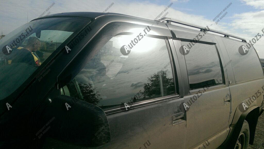Дефлекторы боковых окон Chevrolet Suburban IX (1991-2001)Дефлекторы боковых окон<br>Дефлекторы боковых окон индивидуальны для каждого автомобиля. Продукция изготовлена с помощью точного компьютерного оборудования и новейших технологий. Дефлекторы окон блокируют сильный ветер, бурный поток во...<br>