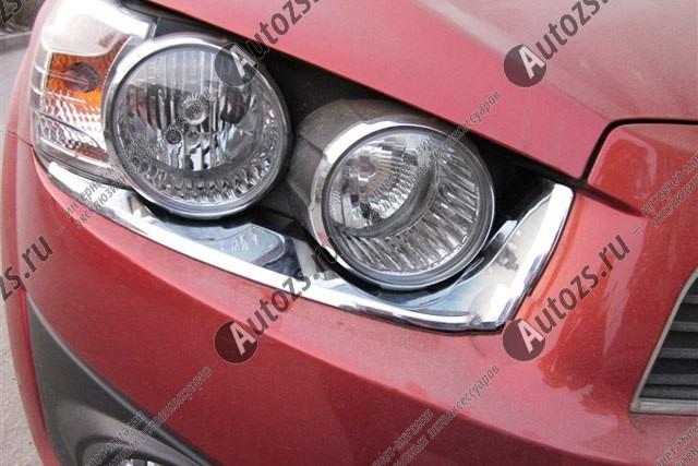 Хромированные накладки на фары Chevrolet Aveo T300 2012+Хромированные накладки Chevrolet Aveo<br>Установка накладок на фары является популярным среди автолюбителей способом внешнего тюнинга автомобилей. Стильные и надежные аксессуары не только служат оригинальными декоративными элементами дизайна, но и выпо...<br>