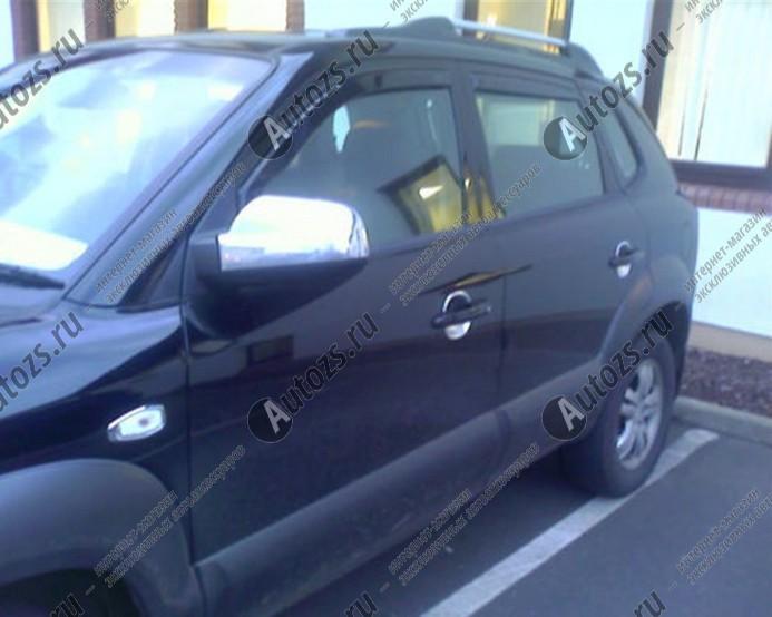 Накладки на зеркала заднего вида Hyundai Tucson 1 2004-2010Хромированные накладки Hyundai Tucson<br>Использование накладок на зеркала придает автомобилю оригинальный и презентабельный вид, эффектно выделяя его из общего потока транспорта. Кроме того, плавные изгибы накладок повышают обтекаемость и улучшают аэро...<br>