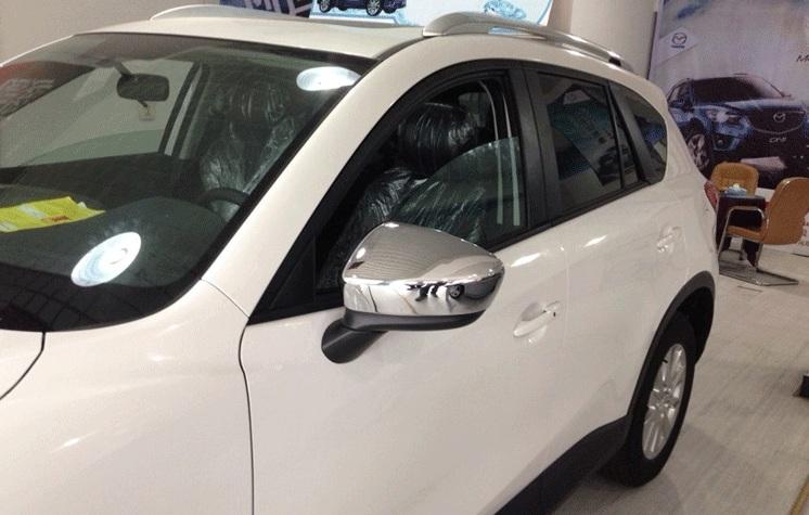 Фото #1: Накладки на зеркала заднего вида Mazda CX-5 1 2011+